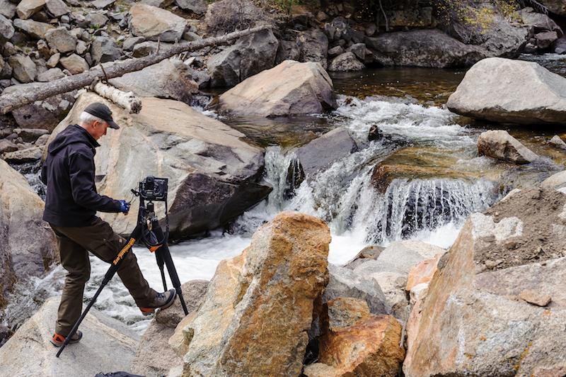 Nikonian shooting a stream